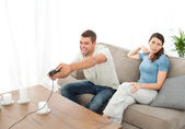 Desperate woman being bored while her boyfriend playing video ga — Stock Photo