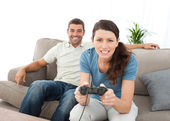 Concentrated woman playing video game with her boyfriend — Stock Photo
