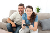 Portrait of a woman playing video game with her boyfriend — 图库照片