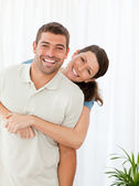 Portrait of a happy couple standing in the living room — Stock Photo