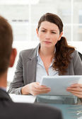 Serious businesswoman questionning a man during a meeting — Stock Photo