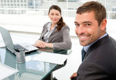 Cheerful business working on a laptop during a meeting — Stock Photo