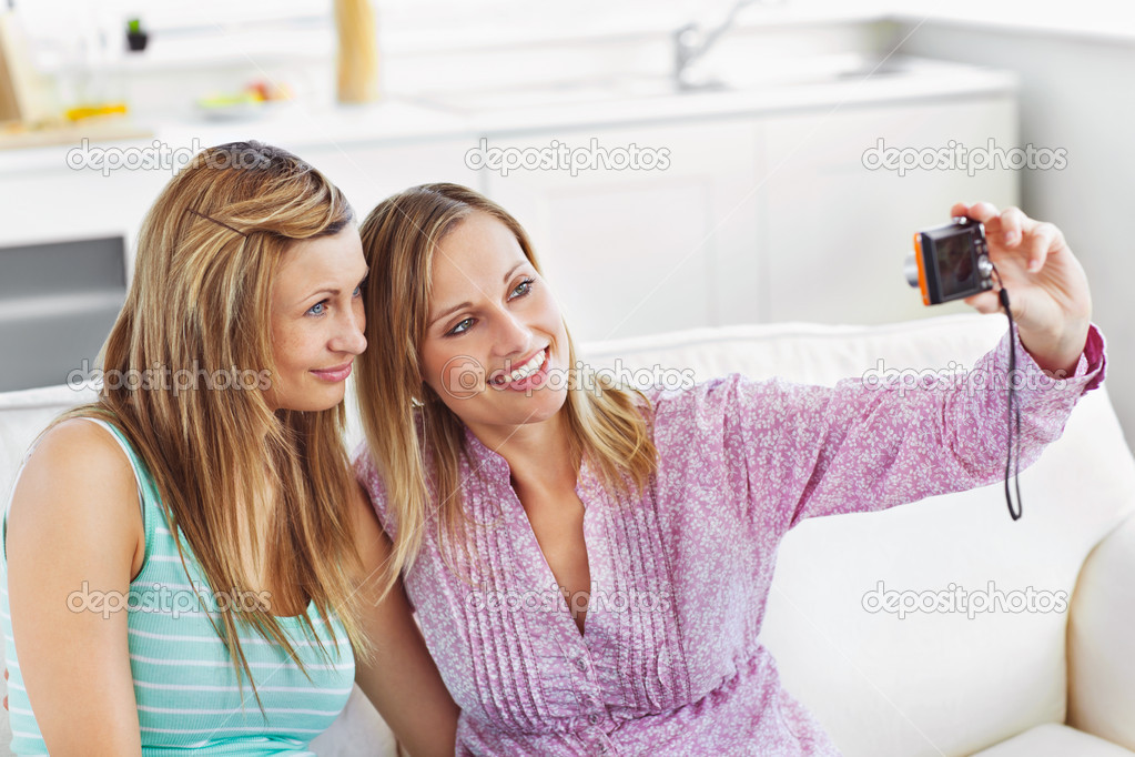 Female friends doing pictures of themselves at home — Stock Photo #10831588
