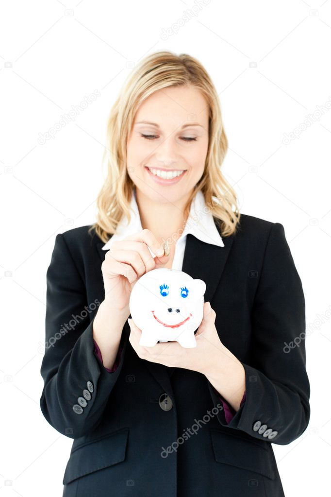 Caucasian woman putting money in a piggybank against a white background — Stock Photo #10832434