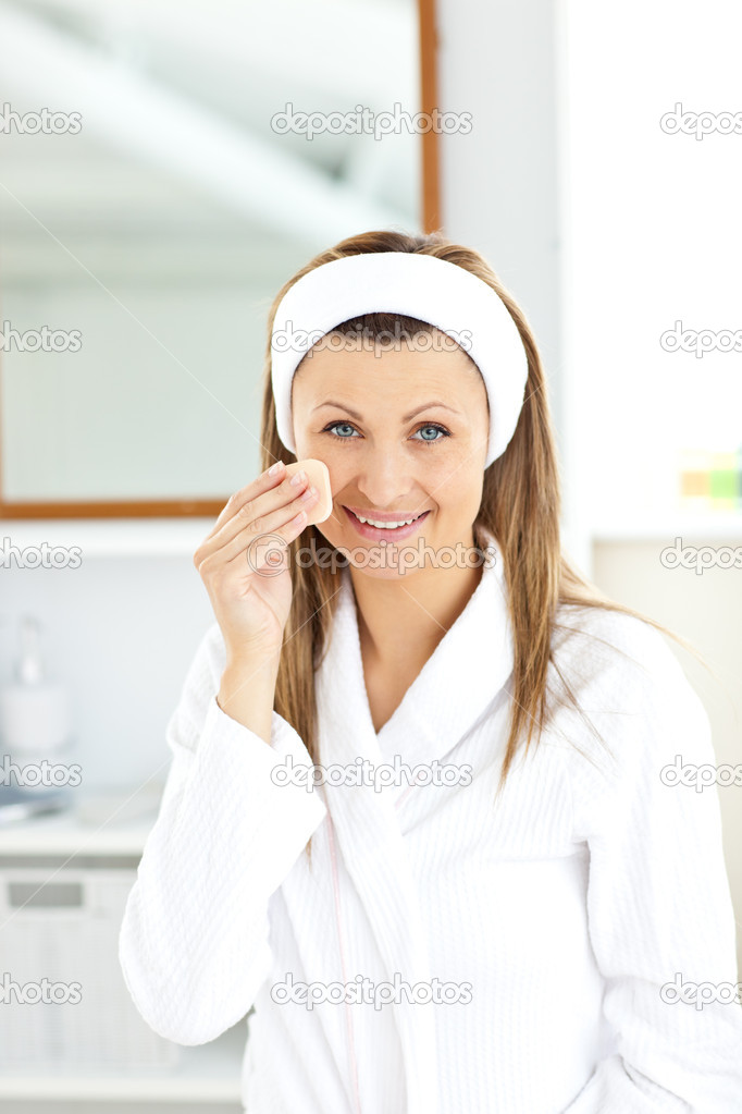 Cheerful woman putting foundation cream in her bathroom at home — Stock Photo #10832653