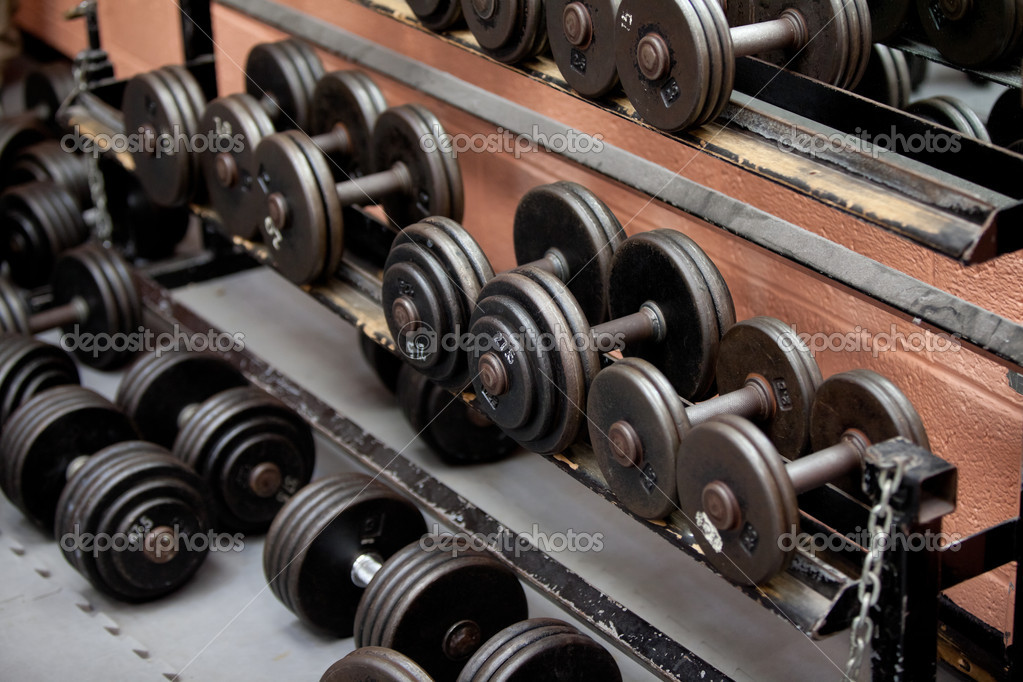 Collection of barbells lying in a sports center  Stock Photo #10834346
