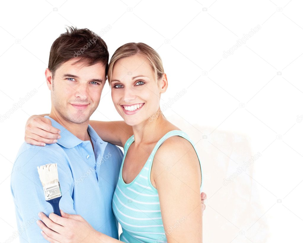 Happy young couple painting a room in their new house — Stock Photo #10834826