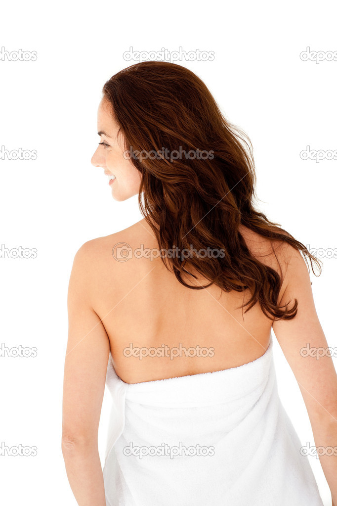 Pretty hispanic woman with a towel on her body against a white background — Stock Photo #10836158