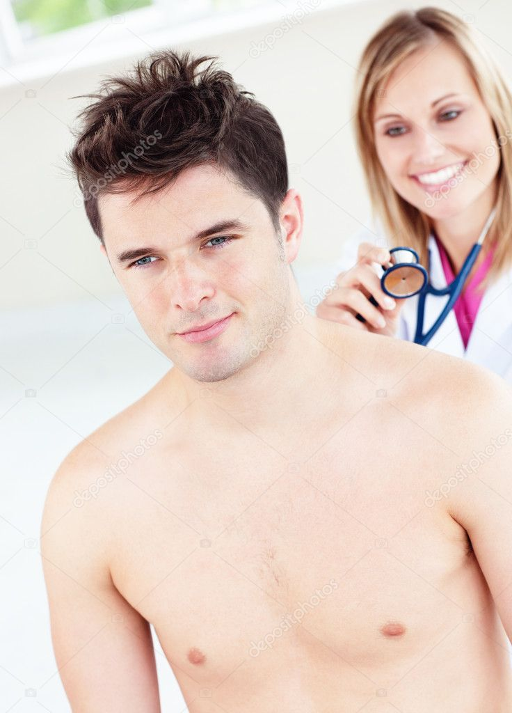 Cute female doctor feeling the breathing of a patient using her stethoscope in her office  Stockfoto #10837812