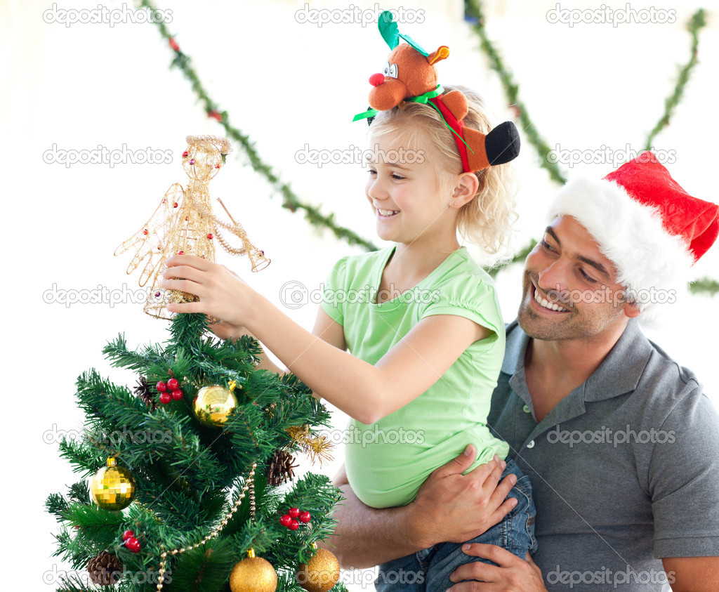Cute little girl decorating the christmas tree with her father at home — Stock fotografie #10838626