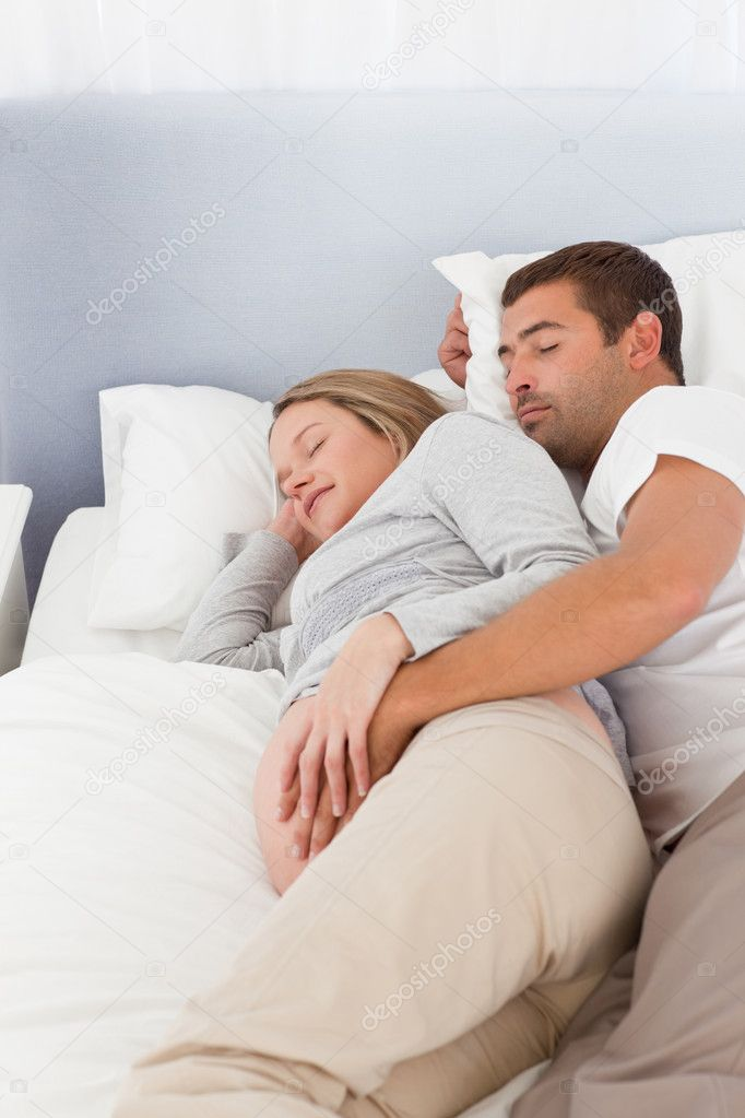 Lovely future parents sleeping in the bedroom at day — Stock Photo #10838855