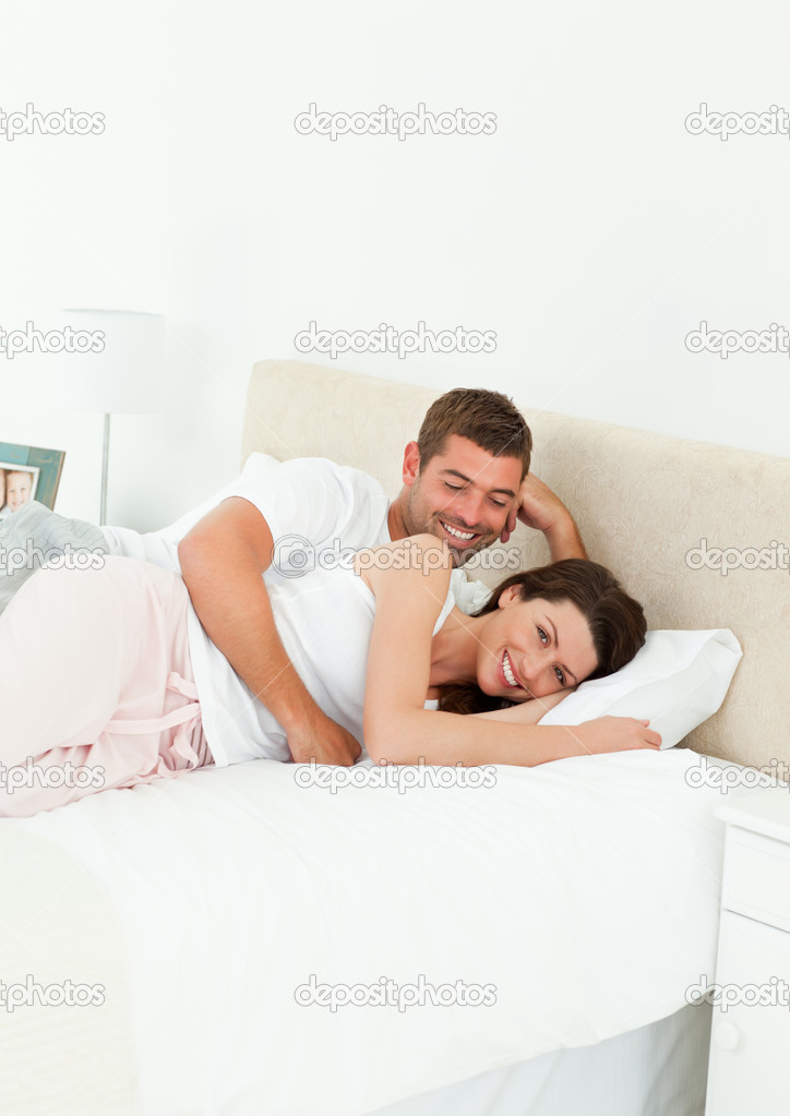 Cute couple lying together in their bedroom during a weekend at home — Stock Photo #10839069
