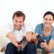 Excited man playing video games wth his girlfriend — Stock Photo #10840048