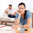 Couple sulking after doing their account together - Stock Photo