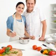 Happy couple preparing a bolognese sauce together — Stock Photo