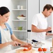 Stock Photo: Couple preparing bolognese sauce and pasta together