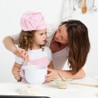 Attentive mother learning her daughter how to cook — Stock Photo