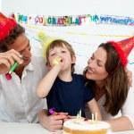 Happy family having fun during a birthday — Stock Photo