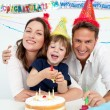 Portrait of a parents celebrating little their son's birthday — Stock Photo
