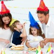 Beautiful mom serving a birthday cake to her family — Stock Photo