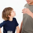 Little boy watching his father drinking milk — Stock Photo #10840411