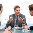 Stock Photo: Charismatic chairman talking with his team