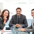 Portrait of a positive team sitting at a table — Stock Photo #10840435