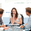Thoughtful businesswoman at a table with her team — Stock Photo