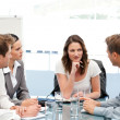 Charismatic businesswoman at a table with her team — Stock Photo #10840455