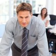 Confident man posing in front of his colleague during a meeting — Stock Photo #10840517