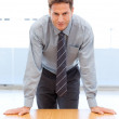 Confident businessman posing leaning on a table — Stock Photo #10840519