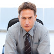 Serious manager sitting at a table — Stock Photo #10840522