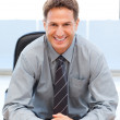 Happy manager sitting at a table — Stock Photo