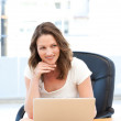 Happy businesswoman working on laptop at a table — Stock Photo #10840551