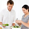 Happy woman serving salad to his boyfriend for the lunch — Stock Photo