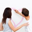 Rear view of a man drawing a heart for his girlfriend — Stock Photo