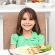 Cute little girl eating pasta and salad — Stock Photo #10840969