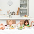Concentrated family praying before having lunch — Stock Photo