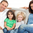 Portrait of a family on the sofa — Stock Photo #10840987