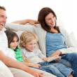 Happy family watching television together — Stock Photo #10840988