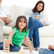 Happy children playing with dominoes in the living room — Stock Photo #10841005