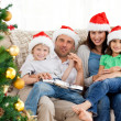 Portrait of a family at Christmas on the sofa — Stock fotografie