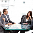 Stock Photo: Thoughtful businesswoman talking to her team during a meeting