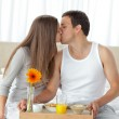 Happy woman kissing her boyfriend for bringing the breakfast — Stock Photo