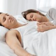Cute couple sleeping together on their bed — Stock Photo