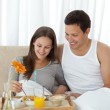 Young woman having breakfast on the bed with her boyfriend — Stock Photo #10841426