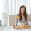 Portrait of a young woman having breakfast on the bed — Stock Photo #10841432