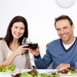 Portrait of happy couple drinking red wine at lunch — Stock Photo #10841461