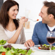 Passionate woman giving a tomato to her boyfriend while having l — Stock Photo #10841466