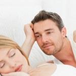 Boyfriend looking at his girlfriend who is sleeping — Stock Photo